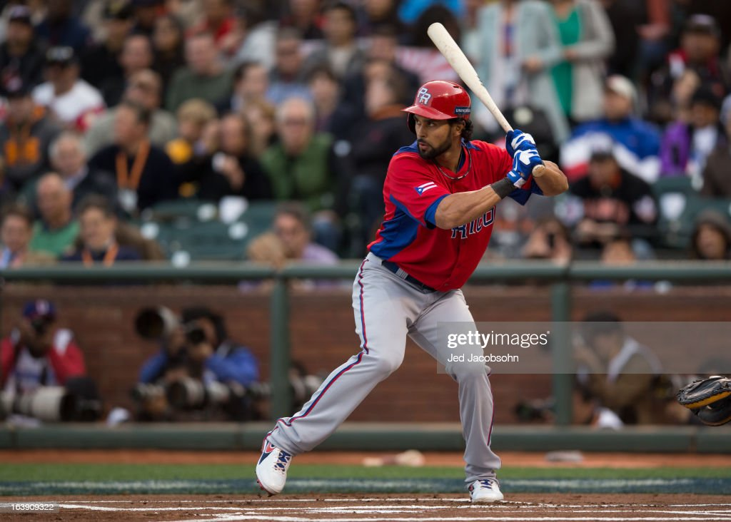 Angel Pagan #16 of Team Puerto Rico bats during the semi-final game against Team Japan in the championship round of the 2013 World Baseball Classic on Sunday, March 17, 2013 at AT&T Park in San Francisco, California.