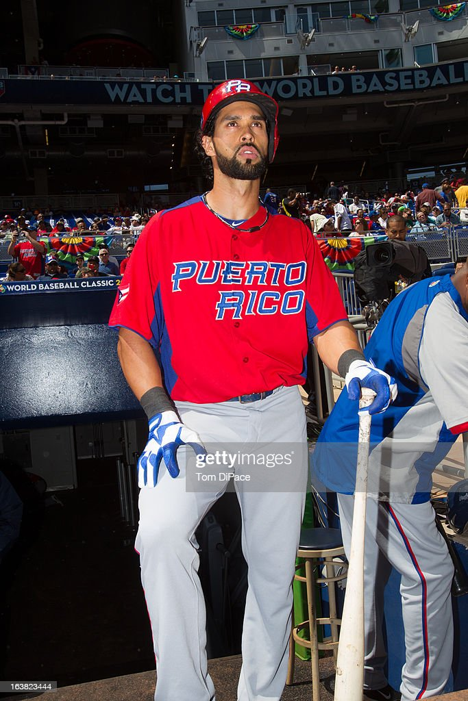 Angel Pagan #16 of Team Puerto Rico is seen in the dugout before Pool 2, Game 6 against Team Dominican Republic in the second round of the 2013 World Baseball Classic on Saturday, March 16, 2013 at Marlins Park in Miami, Florida.