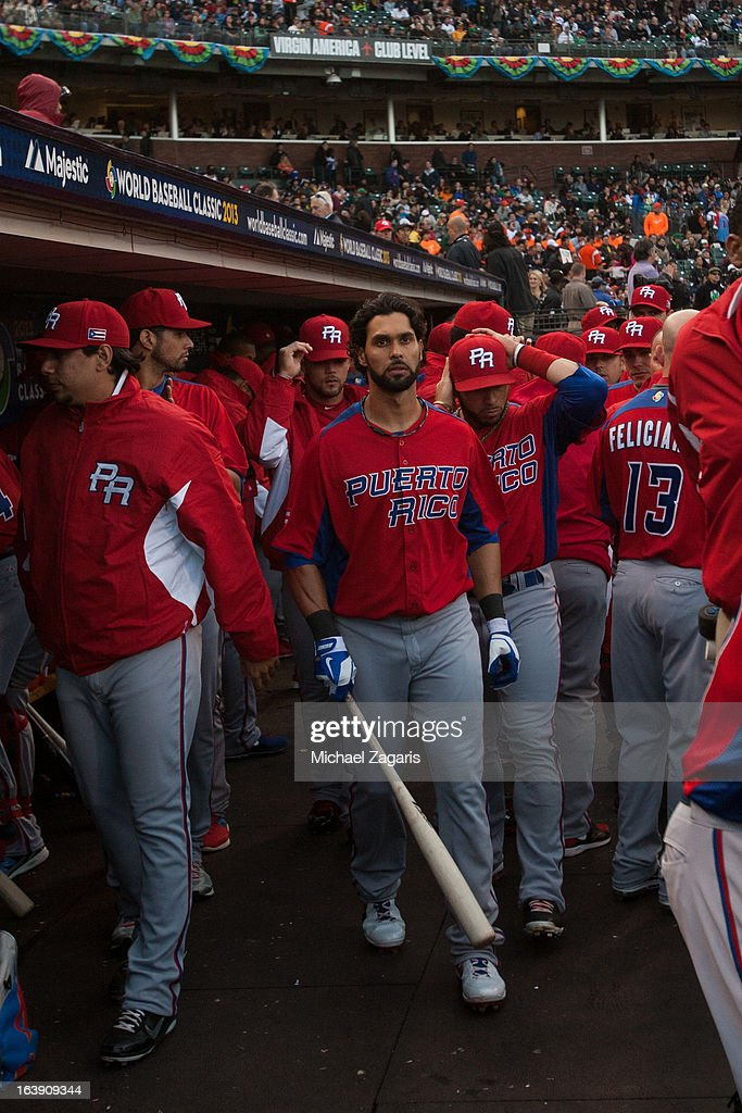 Angel Pagan #16 of Team Puerto Rico is seen in the dugout before the semi-final game against Team Japan in the championship round of the 2013 World Baseball Classic on Sunday, March 17, 2013 at AT&T Park in San Francisco, California.