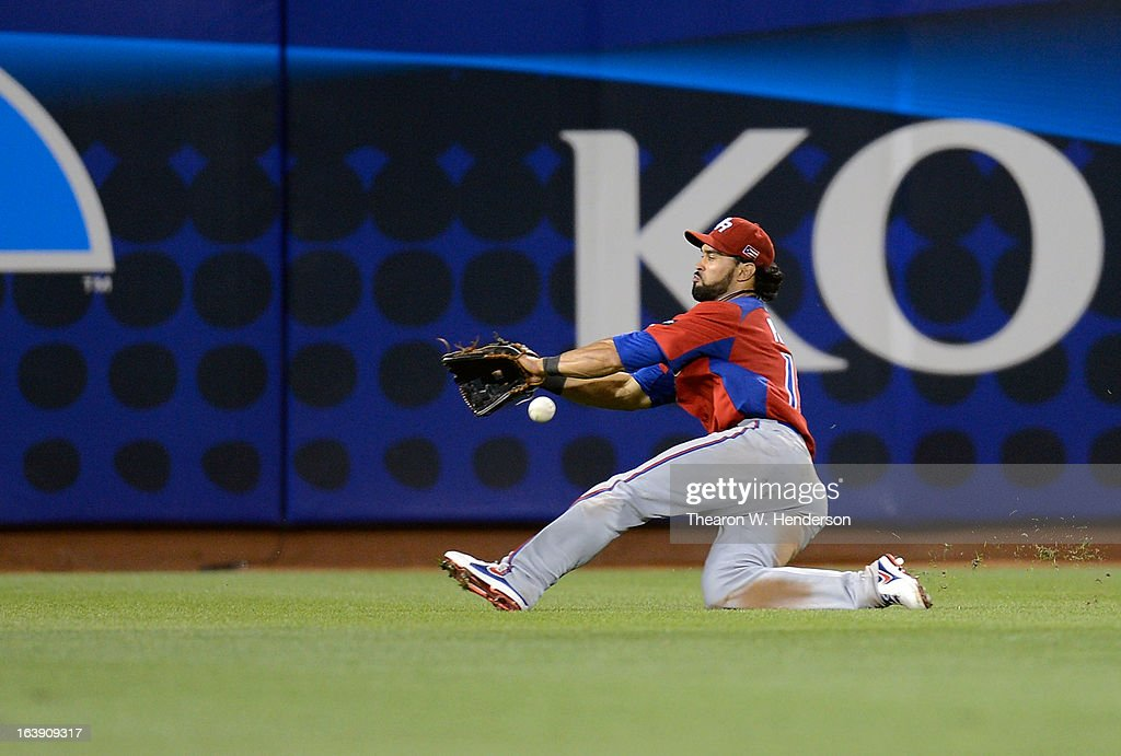 <a gi-track='captionPersonalityLinkClicked' href=/galleries/search?phrase=Angel+Pagan&family=editorial&specificpeople=666596 ng-click='$event.stopPropagation()'>Angel Pagan</a> #16 of Team Puerto Rico lets the ball get by him for a triple off the bat of Seiichi Uchikawa #24 of Team Japan (not pictured) in the six inning during the World Baseball Classic Semifinals at AT&T Park on March 17, 2013 in San Francisco, California. Team Puerto Rico won the game 3-1.