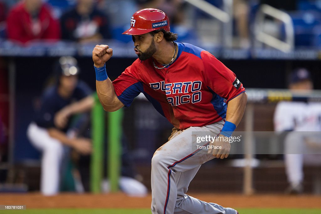 Angel Pagan #16 of Team Puerto Rico reacts as he crosses the plate to score on Mike Aviles' single in the top of the first inning of Pool 2, Game 4 against Team USA in the second round of the 2013 World Baseball Classic on Friday, March 15, 2013 at Marlins Park in Miami, Florida.