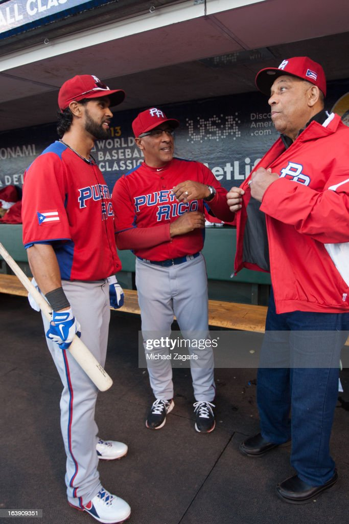 Angel Pagan #16 of Team Puerto Rico talks to manager Edwin Rodriguez and Orlando Cepeda in the dugout before the semi-final game against Team Japan in the championship round of the 2013 World Baseball Classic on Sunday, March 17, 2013 at AT&T Park in San Francisco, California.