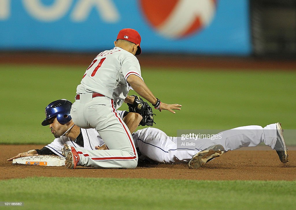 Angel Pagan #16 of the New York Mets is tagged out trying to steal second base by Wilson Valdez #21 of the Philadelphia Phillies during their game on May 27, 2010 at Citi Field in the Flushing neighborhood of the Queens borough of New York City.