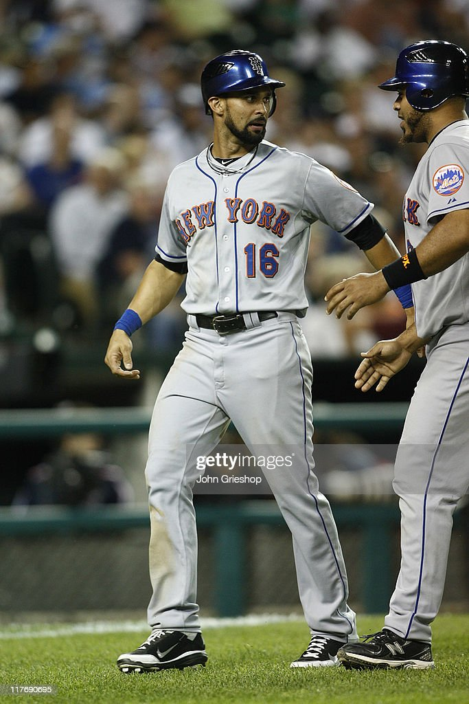 <a gi-track='captionPersonalityLinkClicked' href=/galleries/search?phrase=Angel+Pagan&family=editorial&specificpeople=666596 ng-click='$event.stopPropagation()'>Angel Pagan</a> #16 of the New York Mets receives congratulations after scoring a run during the game against the Detroit Tigers on June 29, 2011 at Comerica Park in Detroit, Michigan. The Mets defeated the Tigers 16-9.