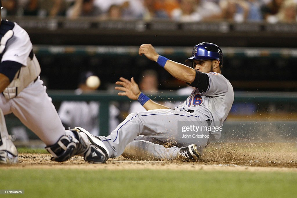 <a gi-track='captionPersonalityLinkClicked' href=/galleries/search?phrase=Angel+Pagan&family=editorial&specificpeople=666596 ng-click='$event.stopPropagation()'>Angel Pagan</a> #16 of the New York Mets slides in safely at home plate during the game against the Detroit Tigers on June 29, 2011 at Comerica Park in Detroit, Michigan. The Mets defeated the Tigers 16-9.