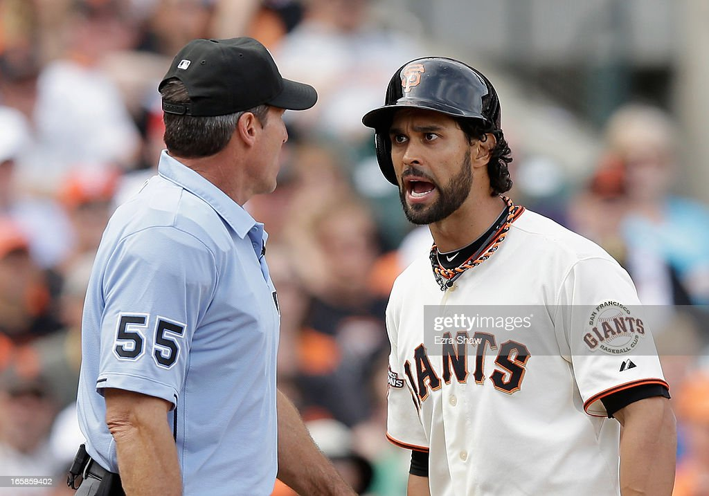 Angel Pagan #16 of the San Francisco Giants argues with home plate umpire Angel Hernandez after he struck out in the seventh inning of their game against the St. Louis Cardinals at AT&T Park on April 6, 2013 in San Francisco, California.