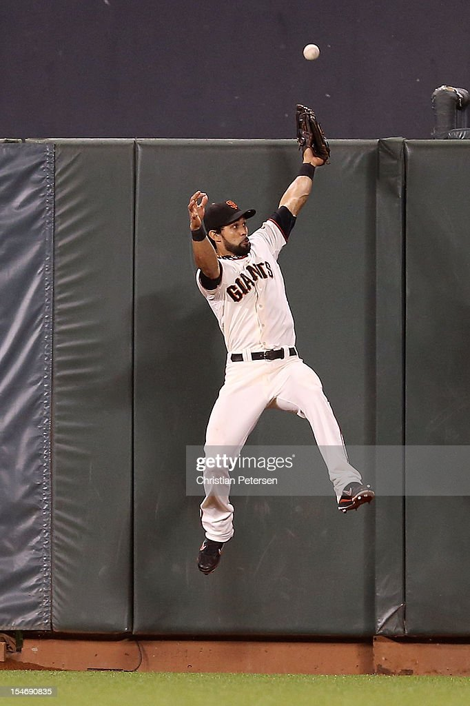 <a gi-track='captionPersonalityLinkClicked' href=/galleries/search?phrase=Angel+Pagan&family=editorial&specificpeople=666596 ng-click='$event.stopPropagation()'>Angel Pagan</a> #16 of the San Francisco Giants can't make a play on Jhonny Peralta #27 of the Detroit Tigers two run home run against Jose Mijares #50 of the San Francisco Giants in the ninth inning during Game One of the Major League Baseball World Series at AT&T Park on October 24, 2012 in San Francisco, California.