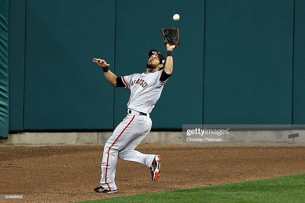 Angel Pagan #16 of the San Francisco Giants catches a pop out fly ball hit by Jhonny Peralta #27 of the Detroit Tigers to deep center field in the ninth inning during Game Four of the Major League Baseball World Series at Comerica Park on October 28, 2012 in Detroit, Michigan.