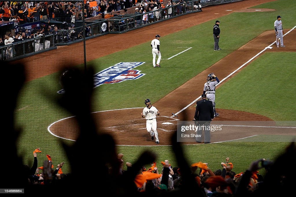 <a gi-track='captionPersonalityLinkClicked' href=/galleries/search?phrase=Angel+Pagan&family=editorial&specificpeople=666596 ng-click='$event.stopPropagation()'>Angel Pagan</a> #16 of the San Francisco Giants celebrates after scoring a run hit by Marco Scutaro #19 of the San Francisco Giants against Justin Verlander #35 of the Detroit Tigers in the third inning during Game One of the Major League Baseball World Series at AT&T Park on October 24, 2012 in San Francisco, California.