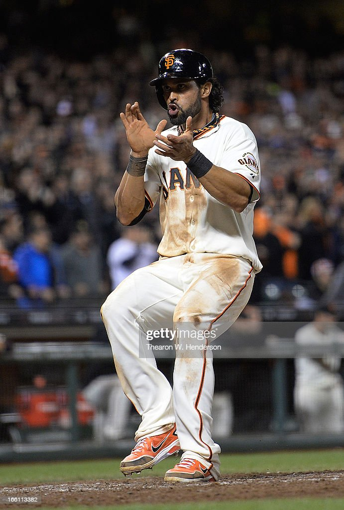 Angel Pagan #16 of the San Francisco Giants celebrates after scoring on a Buster Posey RBI single against the Colorado Rockies in the eighth inning at AT&T Park on April 8, 2013 in San Francisco, California. The Giants won the game 4-2.