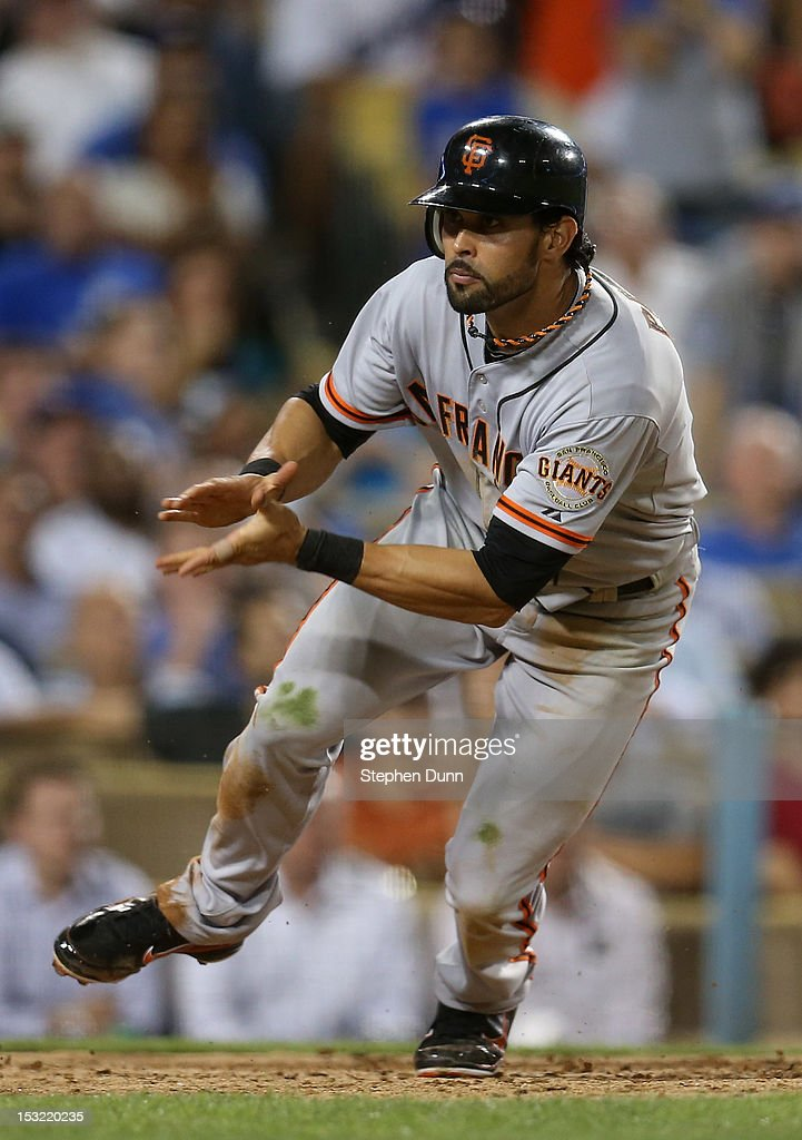 <a gi-track='captionPersonalityLinkClicked' href=/galleries/search?phrase=Angel+Pagan&family=editorial&specificpeople=666596 ng-click='$event.stopPropagation()'>Angel Pagan</a> #16 of the San Francisco Giants celebrates as he comes up after sliding home with the tying run in the eighth inning against the Los Angeles Dodgers on October 1, 2012 at Dodger Stadium in Los Angeles, California.