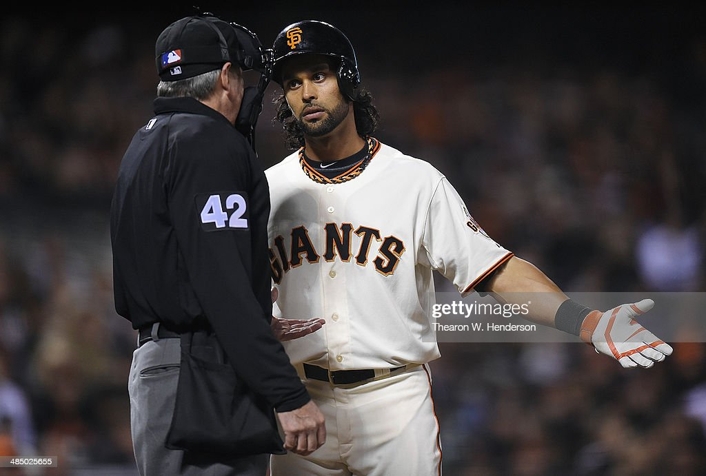 <a gi-track='captionPersonalityLinkClicked' href=/galleries/search?phrase=Angel+Pagan&family=editorial&specificpeople=666596 ng-click='$event.stopPropagation()'>Angel Pagan</a> of the San Francisco Giants complains about a third-strike call to home-plate umpire Mike Winters in the bottom of the seventh inning against the Los Angeles Dodgers at AT&T Park on April 15, 2014 in San Francisco, California. All uniformed team members are wearing jersey number 42 in honor of Jackie Robinson Day.