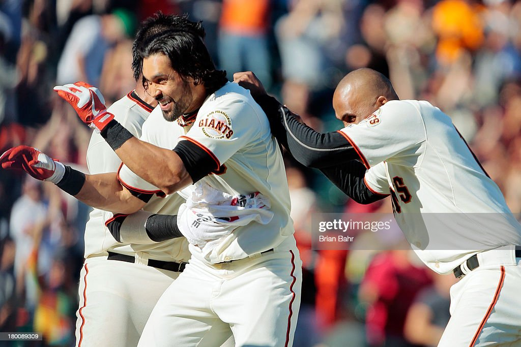 <a gi-track='captionPersonalityLinkClicked' href=/galleries/search?phrase=Angel+Pagan&family=editorial&specificpeople=666596 ng-click='$event.stopPropagation()'>Angel Pagan</a> #16 of the San Francisco Giants gets swarmed by his team after he hit a walk-off single to score Ehire Adrianza against the Arizona Diamondbacks in the 11th inning at AT&T Park on September 8, 2013 in San Francisco, California. The Giants won 3-2 in 11 innnings.