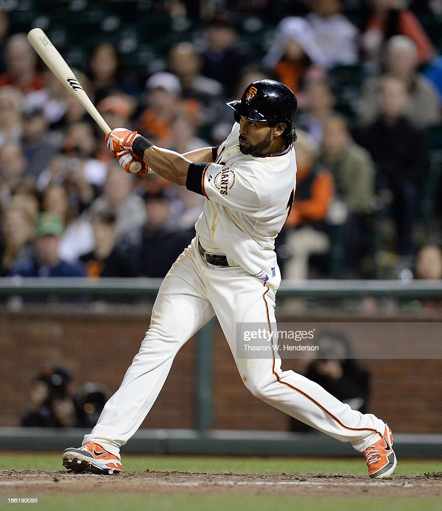 <a gi-track='captionPersonalityLinkClicked' href=/galleries/search?phrase=Angel+Pagan&family=editorial&specificpeople=666596 ng-click='$event.stopPropagation()'>Angel Pagan</a> #16 of the San Francisco Giants hits a single, driving in Andres Torres for the go-ahead run against the Colorado Rockies in the bottom of the eighth inning at AT&T Park on April 9, 2013 in San Francisco, California. The Giants won the game 9-6.