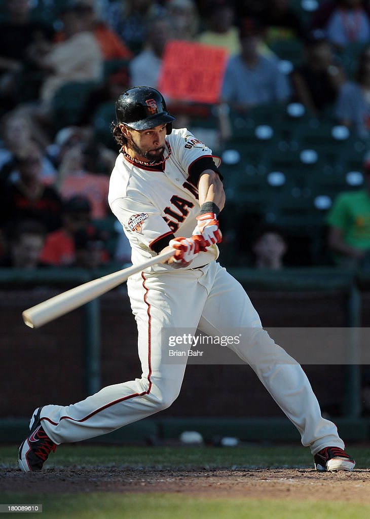 <a gi-track='captionPersonalityLinkClicked' href=/galleries/search?phrase=Angel+Pagan&family=editorial&specificpeople=666596 ng-click='$event.stopPropagation()'>Angel Pagan</a> #16 of the San Francisco Giants hits the game winning single against the Arizona Diamondbacks in the 11th inning at AT&T Park on September 8, 2013 in San Francisco, California. The Giants won 3-2 in 11 innnings.
