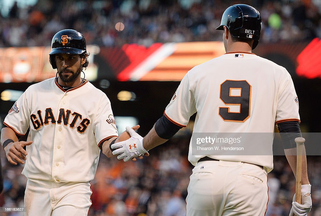 <a gi-track='captionPersonalityLinkClicked' href=/galleries/search?phrase=Angel+Pagan&family=editorial&specificpeople=666596 ng-click='$event.stopPropagation()'>Angel Pagan</a> #16 of the San Francisco Giants is congratulated by <a gi-track='captionPersonalityLinkClicked' href=/galleries/search?phrase=Brandon+Belt&family=editorial&specificpeople=7513394 ng-click='$event.stopPropagation()'>Brandon Belt</a> #9 after Pagan scored against the Colorado Rockies in the first inning at AT&T Park on April 9, 2013 in San Francisco, California.