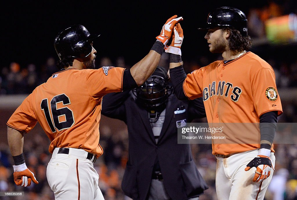 Angel Pagan #16 of the San Francisco Giants is congratulated by Brandon Crawford #35 after Pagan hit a two-run homer against the Atlanta Braves in the six inning at AT&T Park on May 10, 2013 in San Francisco, California. Crawford scored ahead of Pagan on the homer.