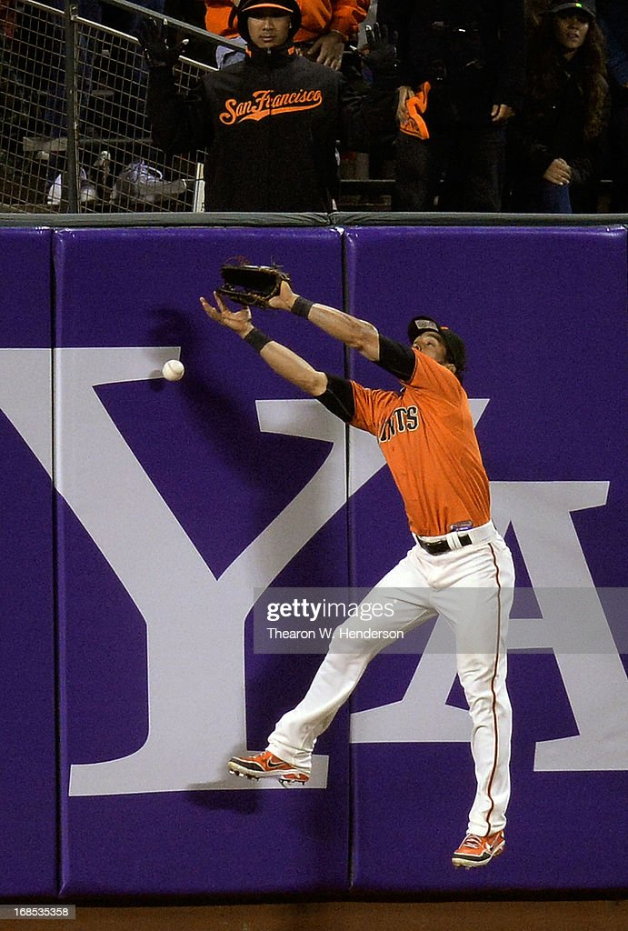 <a gi-track='captionPersonalityLinkClicked' href=/galleries/search?phrase=Angel+Pagan&family=editorial&specificpeople=666596 ng-click='$event.stopPropagation()'>Angel Pagan</a> #16 of the San Francisco Giants leaps but can't come up with the ball that goes off the wall for a double, off the bat of Justin Upton #8 of the Atlanta Braves in the fourth inning at AT&T Park on May 10, 2013 in San Francisco, California.