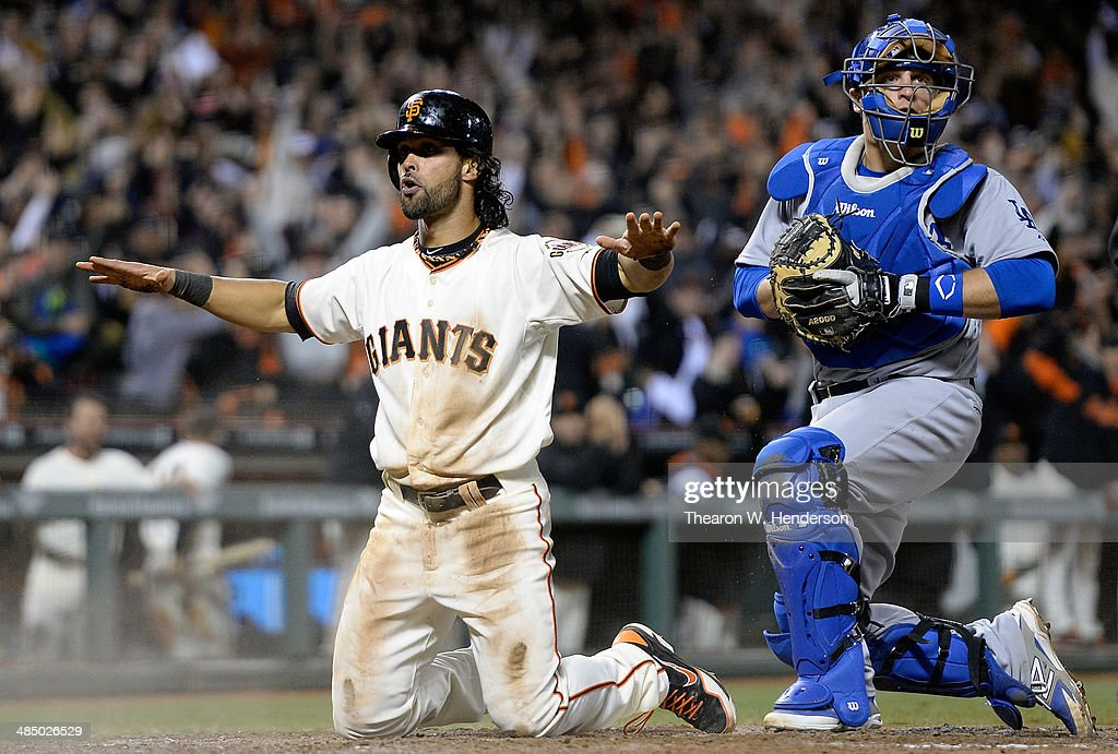 <a gi-track='captionPersonalityLinkClicked' href=/galleries/search?phrase=Angel+Pagan&family=editorial&specificpeople=666596 ng-click='$event.stopPropagation()'>Angel Pagan</a> of the San Francisco Giants reacts after he scored the tying run in the bottom of the ninth inning as catcher Tim Fedorwicz of the Los Angeles Dodgers looks on at AT&T Park on April 15, 2014 in San Francisco, California. Every team member is wearing the jersey #42 in honor of Jackie Robinson Day.