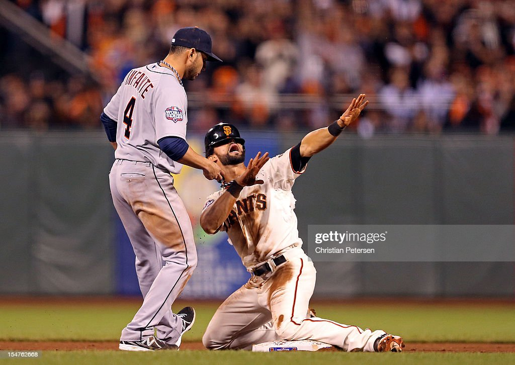 <a gi-track='captionPersonalityLinkClicked' href=/galleries/search?phrase=Angel+Pagan&family=editorial&specificpeople=666596 ng-click='$event.stopPropagation()'>Angel Pagan</a> #16 of the San Francisco Giants reacts after he successfully stole second base against <a gi-track='captionPersonalityLinkClicked' href=/galleries/search?phrase=Omar+Infante&family=editorial&specificpeople=203255 ng-click='$event.stopPropagation()'>Omar Infante</a> #4 of the Detroit Tigers in the eighth inning during Game Two of the Major League Baseball World Series at AT&T Park on October 25, 2012 in San Francisco, California.