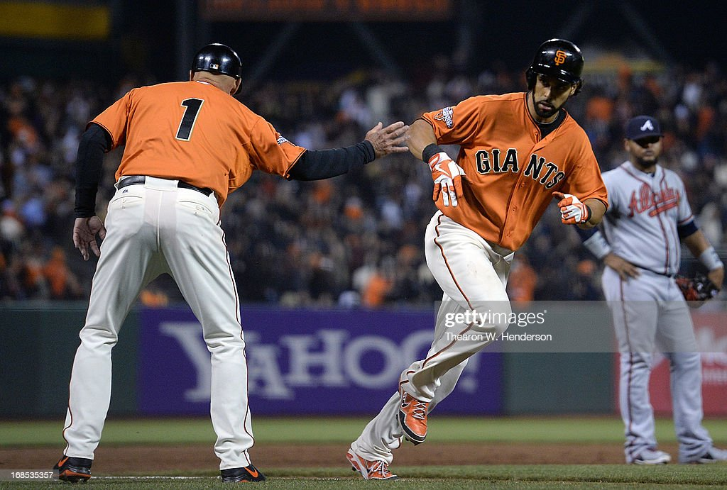 <a gi-track='captionPersonalityLinkClicked' href=/galleries/search?phrase=Angel+Pagan&family=editorial&specificpeople=666596 ng-click='$event.stopPropagation()'>Angel Pagan</a> #16 of the San Francisco Giants rounds third base is congratulated by coach <a gi-track='captionPersonalityLinkClicked' href=/galleries/search?phrase=Tim+Flannery&family=editorial&specificpeople=691944 ng-click='$event.stopPropagation()'>Tim Flannery</a> #1 after Pagan hit a two-run homer against the Atlanta Braves in the six inning at AT&T Park on May 10, 2013 in San Francisco, California.