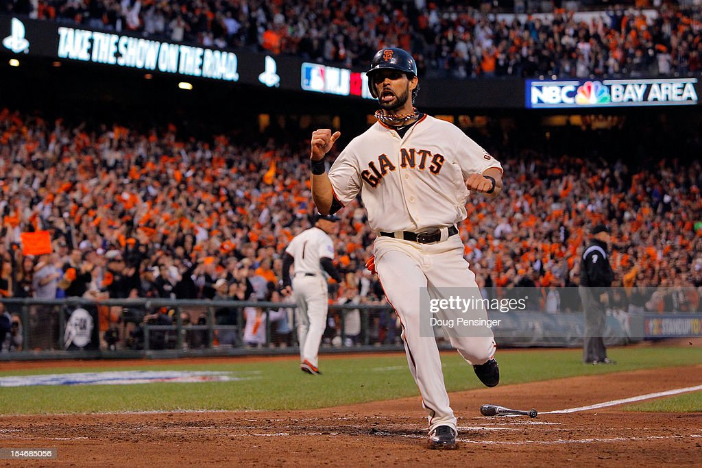 <a gi-track='captionPersonalityLinkClicked' href=/galleries/search?phrase=Angel+Pagan&family=editorial&specificpeople=666596 ng-click='$event.stopPropagation()'>Angel Pagan</a> #16 of the San Francisco Giants scores a run hit by Marco Scutaro #19 of the San Francisco Giants against Justin Verlander #35 of the Detroit Tigers in the third inning during Game One of the Major League Baseball World Series at AT&T Park on October 24, 2012 in San Francisco, California.