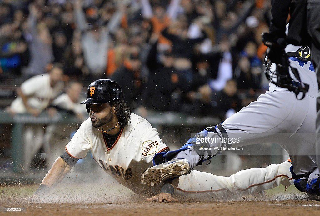 <a gi-track='captionPersonalityLinkClicked' href=/galleries/search?phrase=Angel+Pagan&family=editorial&specificpeople=666596 ng-click='$event.stopPropagation()'>Angel Pagan</a> of the San Francisco Giants scores the tying run on an RBI double from Brandon Belt (not pictured) in the bottom of the ninth inning against the Los Angeles Dodgers at AT&T Park on April 15, 2014 in San Francisco, California. Every team member is wearing the jersey #42 in honor of Jackie Robinson Day.