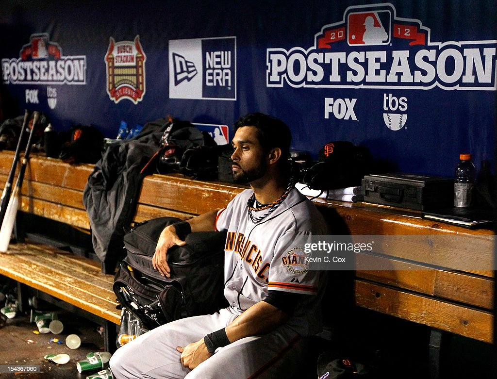<a gi-track='captionPersonalityLinkClicked' href=/galleries/search?phrase=Angel+Pagan&family=editorial&specificpeople=666596 ng-click='$event.stopPropagation()'>Angel Pagan</a> #16 of the San Francisco Giants sits in the dugout after the Giants lose to the St. Louis Cardinals 8-3 in Game Four of the National League Championship Series at Busch Stadium on October 18, 2012 in St Louis, Missouri.