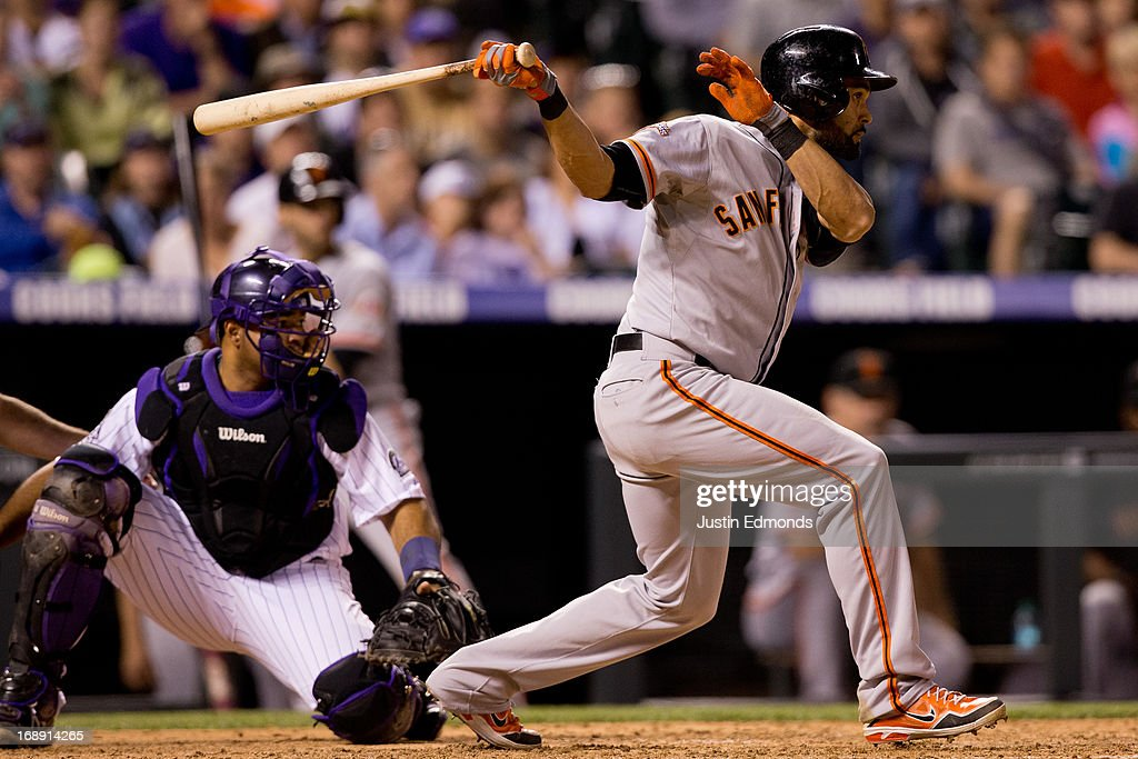 <a gi-track='captionPersonalityLinkClicked' href=/galleries/search?phrase=Angel+Pagan&family=editorial&specificpeople=666596 ng-click='$event.stopPropagation()'>Angel Pagan</a> #16 of the San Francisco Giants watches his two-RBI single for the eventual winning runs fly into the outfield during the sixth inning as catcher <a gi-track='captionPersonalityLinkClicked' href=/galleries/search?phrase=Wilin+Rosario&family=editorial&specificpeople=5734314 ng-click='$event.stopPropagation()'>Wilin Rosario</a> #20 of the Colorado Rockies looks on at Coors Field on May 16, 2013 in Denver, Colorado. The Giants defeated the Rockies 8-6.
