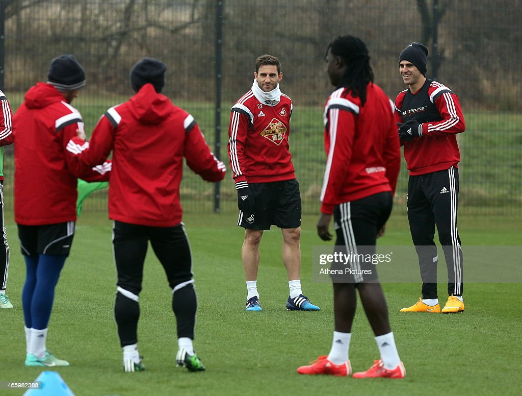Angel Rangel (C) and Nelson Oliveira (R) during the Swansea City training session at Fairwood Training Ground on March 12, 2015 in Swansea, Wales.