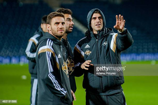 Angel Rangel Jordi Amat and Nelson Oliveira of Swansea City chat on the pitch prior to the Premier League match between West Bromwich Albion and...
