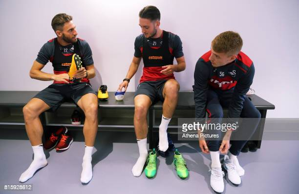 Angel Rangel Matt Grimes and Jay Fulton put their boots on during the Swansea City Training at The Fairwood Training Ground on July 11 2017 in...