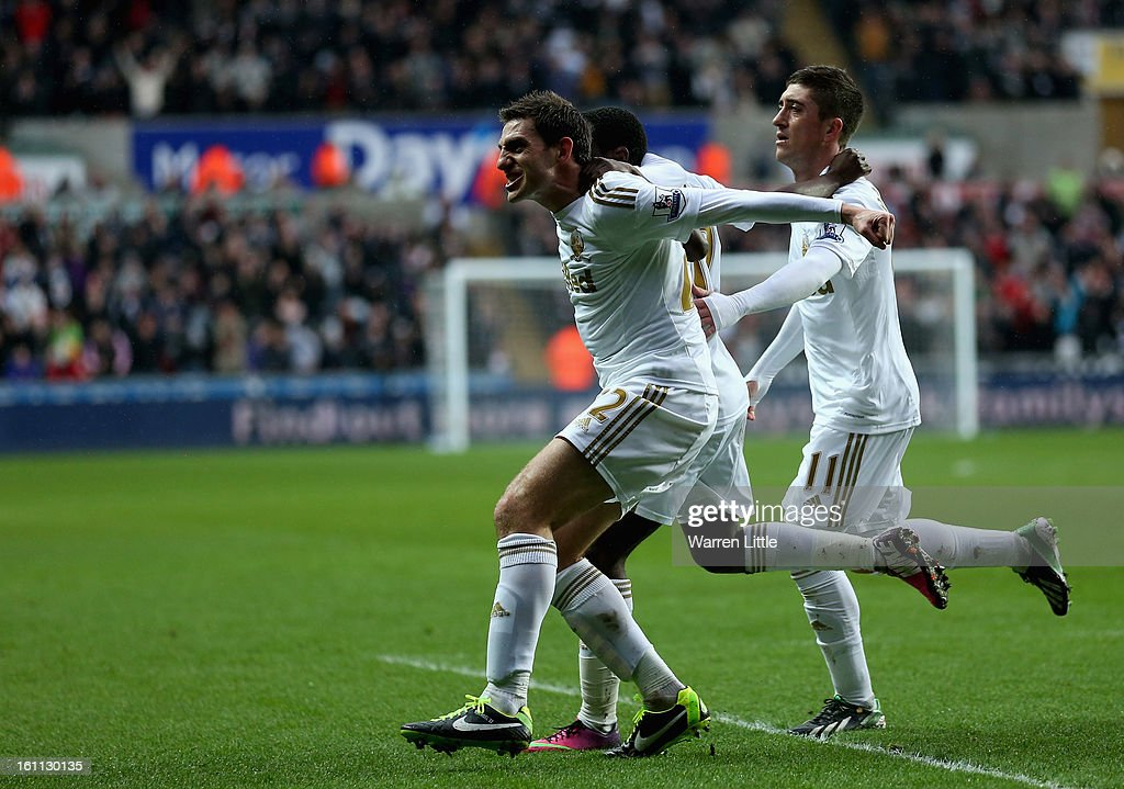 Angel Rangel of Swansea celebrates scoring the second goal during the Premier League match between Swansea City and Queens Park Rangers at Liberty Stadium on February 9, 2013 in Swansea, Wales.