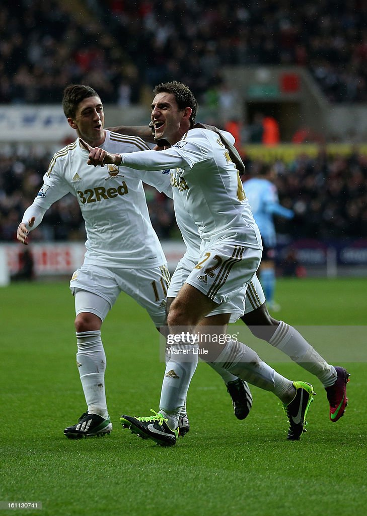Angel Rangel of Swansea celebrates scoring the secong goal during the Premier League match between Swansea City and Queens Park Rangers at Liberty Stadium on February 9, 2013 in Swansea, Wales.