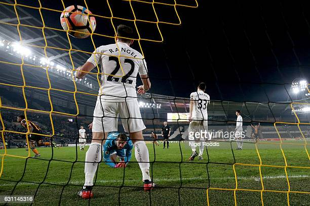 Angel Rangel of Swansea City attempts to stop as Abel Hernandez of Hull City scores his sides first goal during the Emirates FA Cup third round match...