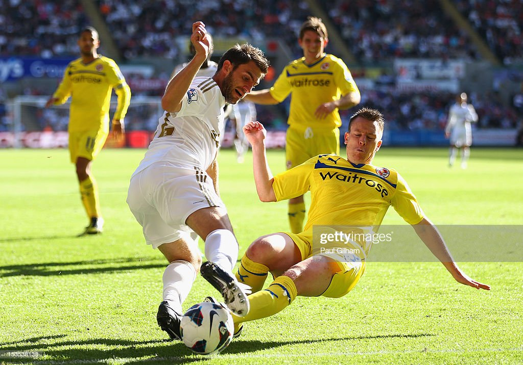 Angel Rangel of Swansea City battles for the ball with <a gi-track='captionPersonalityLinkClicked' href=/galleries/search?phrase=Nicky+Shorey&family=editorial&specificpeople=786022 ng-click='$event.stopPropagation()'>Nicky Shorey</a> of Reading during the Barclays Premier League match between Swansea City and Reading at the Liberty Stadium on October 6, 2012 in Swansea, Wales.