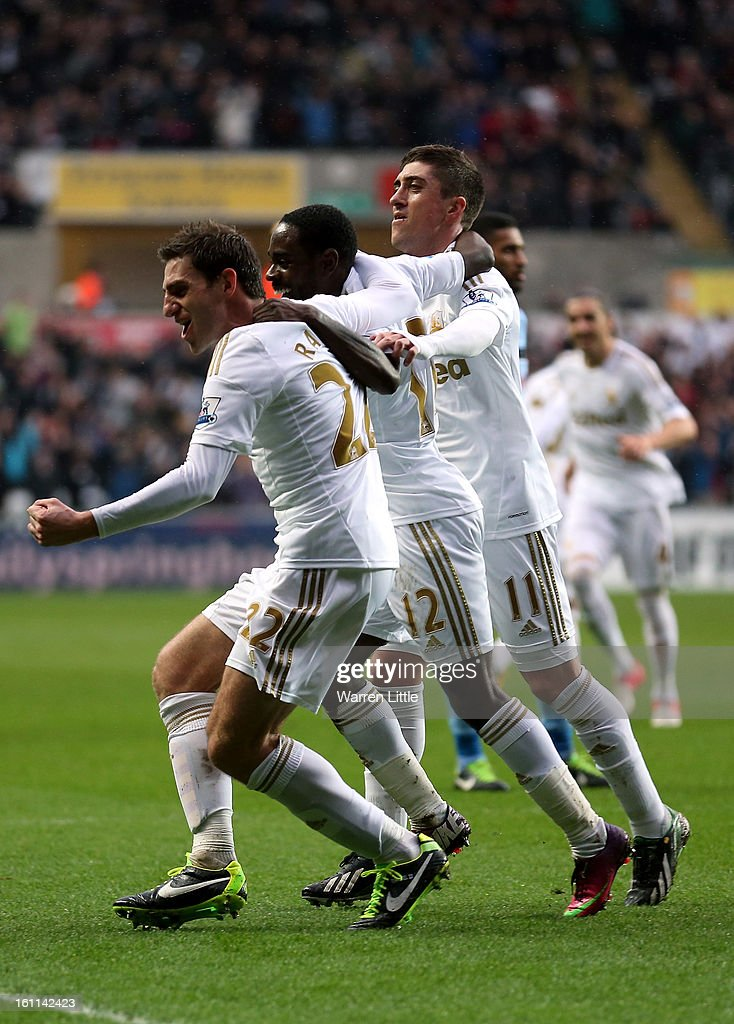 Angel Rangel of Swansea City celebrates scoring the second goal during the Premier League match between Swansea City and Queens Park Rangers at Liberty Stadium on February 9, 2013 in Swansea, Wales.