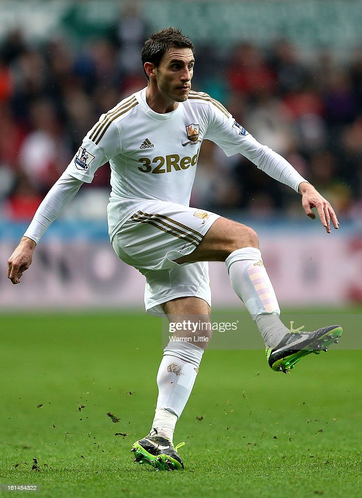 Angel Rangel of Swansea City in action during the Premier League match between Swansea City and Queens Park Rangers at Liberty Stadium on February 9, 2013 in Swansea, Wales.