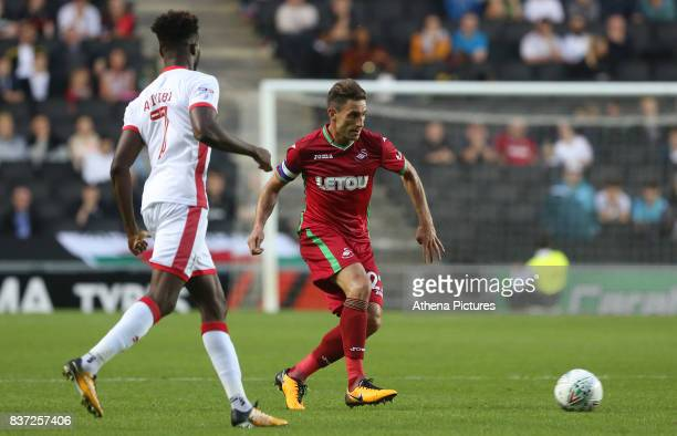 Angel Rangel of Swansea City is marked by Gboly Ariyibi of MK Dons during the Carabao Cup Second Round match between MK Dons and Swansea City at...