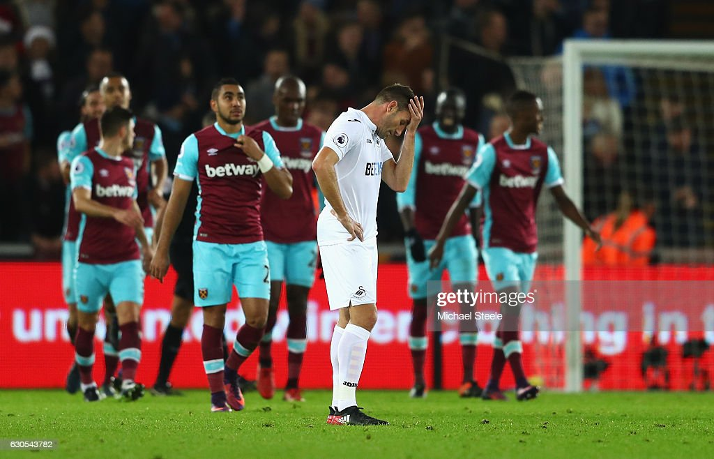 Angel Rangel of Swansea City reacts after the fourth West Ham goal during the Premier League match between Swansea City and West Ham United at Liberty Stadium on December 26, 2016 in Swansea, Wales.