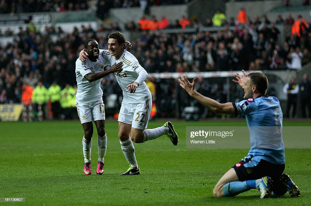 Angel Rangel of Swansea is congratulated by team mate Nathan Dyer after scoring the secong goal during the Premier League match between Swansea City and Queens Park Rangers at Liberty Stadium on February 9, 2013 in Swansea, Wales.