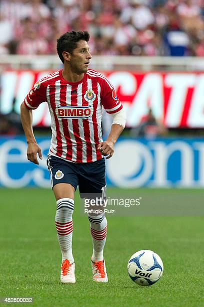 Angel Reyna of Chivas drives the ball during a 2nd round match between Chivas and Cruz Azul as part of the Apertura 2015 Liga MX at Omnilife Stadium...