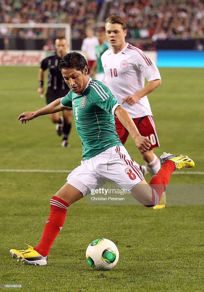 <a gi-track='captionPersonalityLinkClicked' href=/galleries/search?phrase=Angel+Reyna&family=editorial&specificpeople=630365 ng-click='$event.stopPropagation()'>Angel Reyna</a> #8 of Mexico attempts a shot against Denmark during the first half of an international friendly match at University of Phoenix Stadium on January 30, 2013 in Glendale, Arizona. Mexico and Denmark ended in a 1-1 draw.