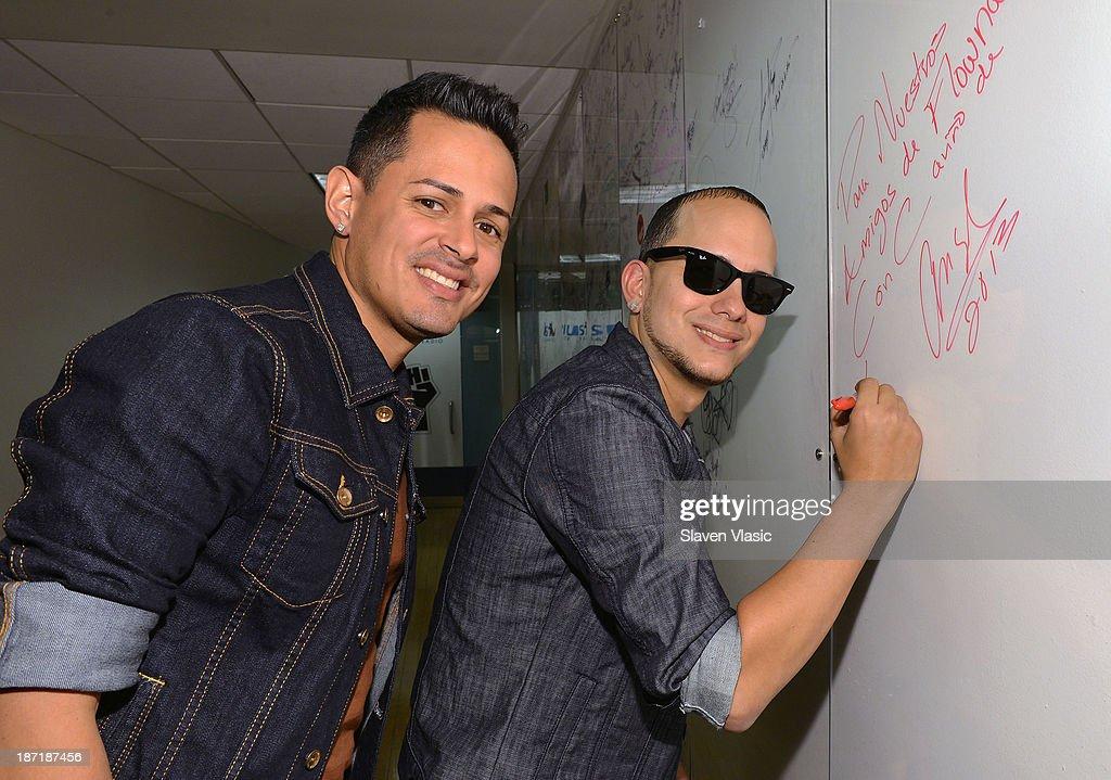 Angel Rivera Guzmn (L) and Christian Coln Rolon of 'Angel & Khriz' visit SiriusXM Studios on November 6, 2013 in New York City.