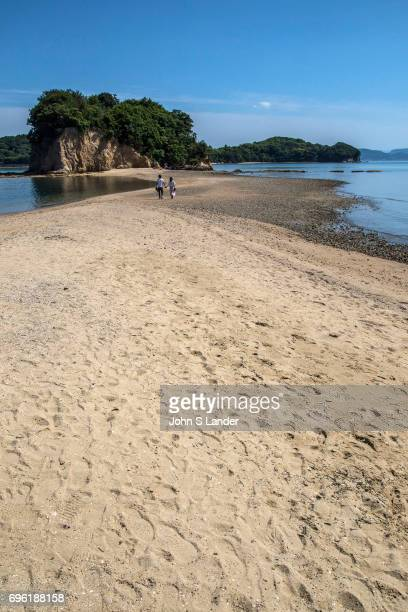 Angel Road is in reality a sandbar that connects three tiny islands with Shodoshima During low tide visitors can walk along the sandbar Local lore...