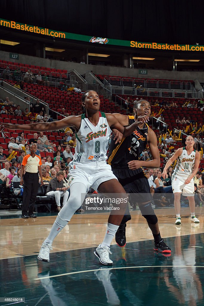 Angel Robinson #8 of the Seattle Storm boxes out against Vicki Baugh #22 of the Tulsa Shock during the game on August 10,2014 at Key Arena in Seattle, Washington.