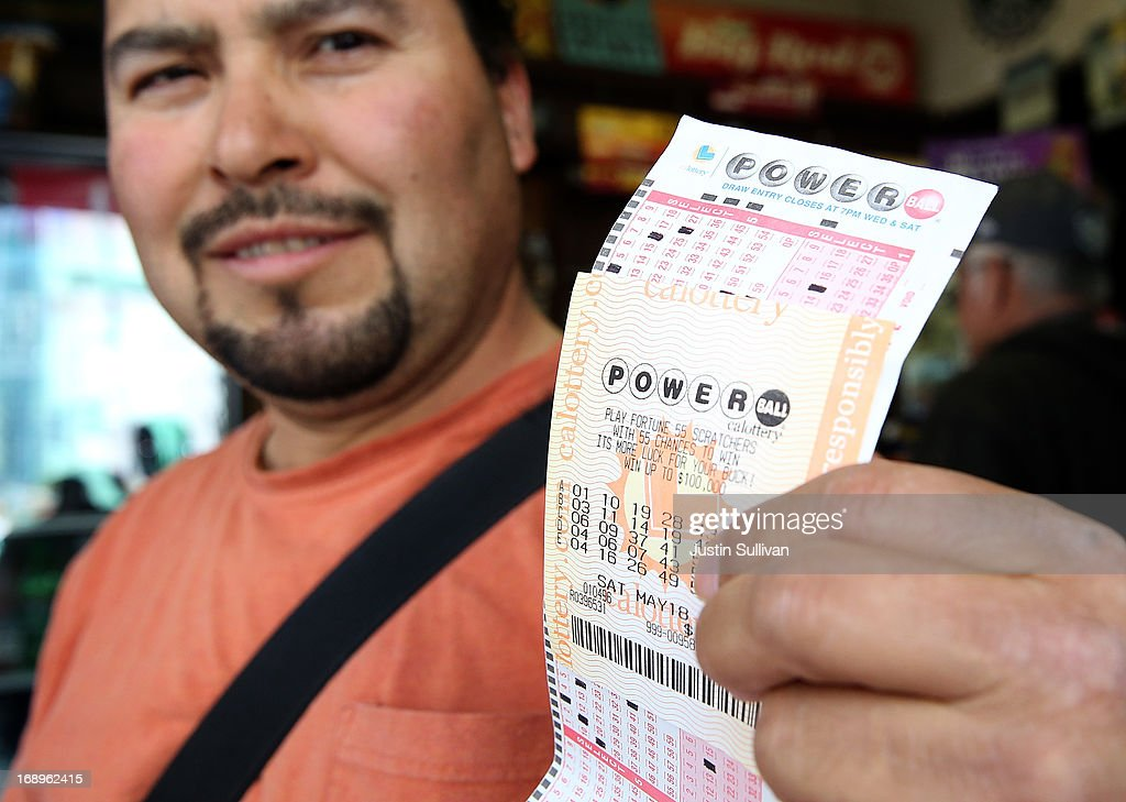 Angel Roblero holds a Powerball ticket that he just purchased on May 17, 2013 in San Francisco, California. People are lining up to purchase $2 Powerball tickets as the multi-state jackpot hits $600 million.