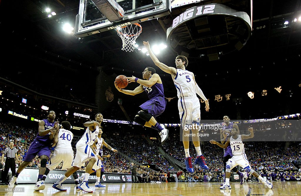 Angel Rodriguez #13 of the Kansas State Wildcats shoots against Jeff Withey #5 of the Kansas Jayhawks in the first half during the Final of the Big 12 basketball tournament at Sprint Center on March 16, 2013 in Kansas City, Missouri.