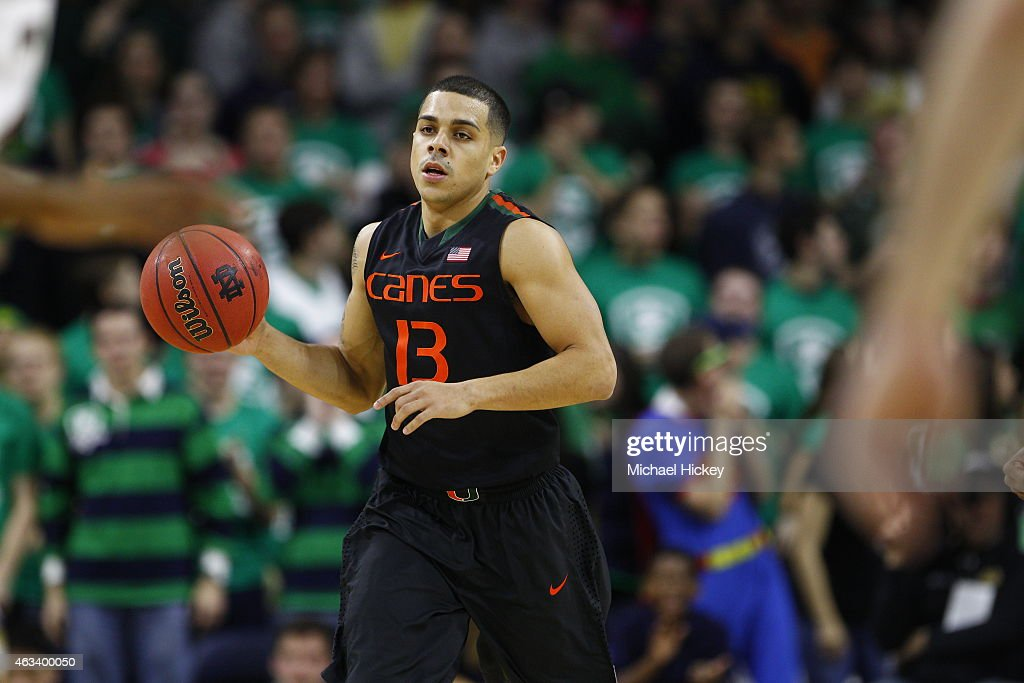 Angel Rodriguez of the Miami Hurricanes brings the ball up court during the game against the Notre Dame Fighting Irish at Purcell Pavilion on January...