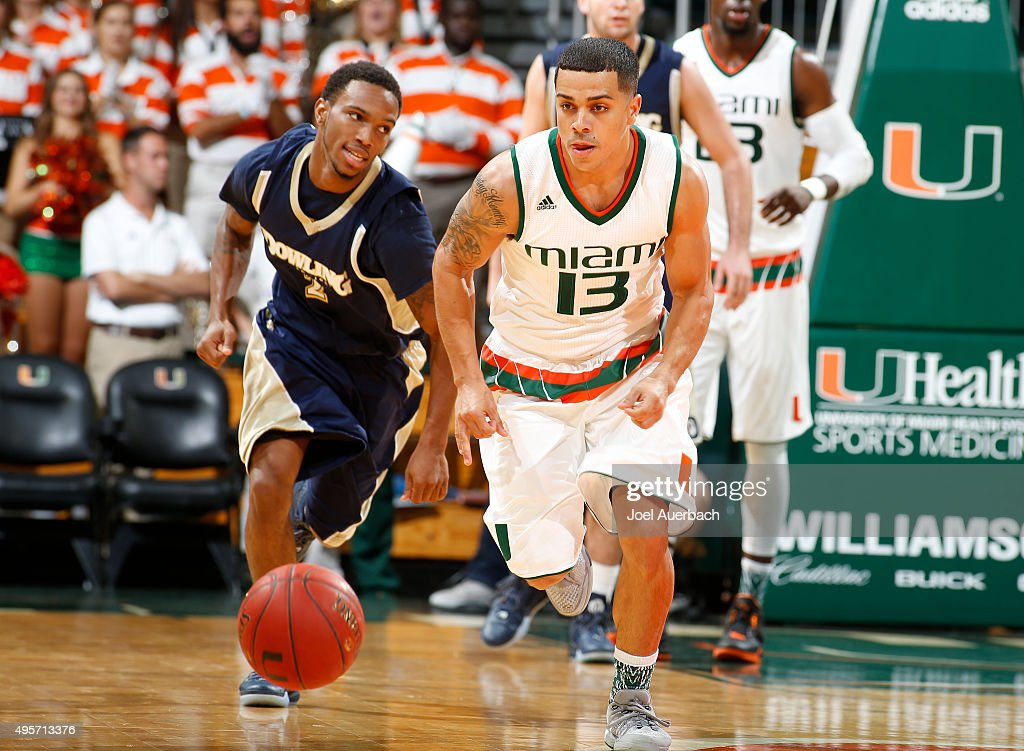 Angel Rodriguez of the Miami Hurricanes chases a loose ball against the Dowling Golden Lions on November 4 2015 at the BankUnited Center in Coral...
